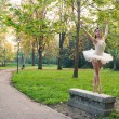 Young beautiful ballerina dancing outdoors in a park. Ballerina project - Foto de Stock