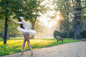 Young beautiful ballerina dancing outdoors in a park. Ballerina project — Stock Photo