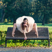 Young beautiful ballerina posing outdoors in a park. Ballerina project — Stock Photo