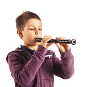 Child playing flute, isolated on white background — Stock Photo