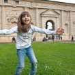 Young girl jumping outdoors - Stock Photo