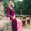 Beautiful girl wearing a burgundy medieval dress. Full body — Stock Photo #19176531