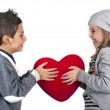 Couple of kids playing with red heart over white background. Valentines — Stock Photo