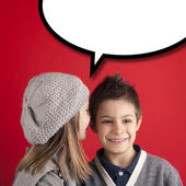 Boy talking to girl over red background with balloon. Valentines — Stock Photo