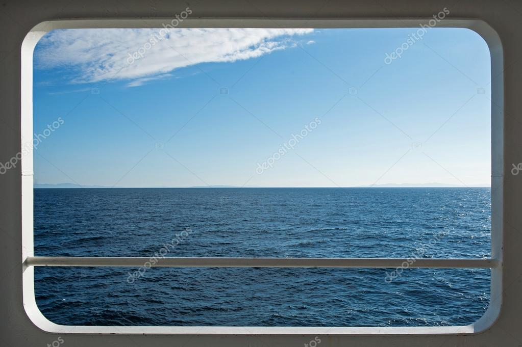 Ship windows with a relaxing seascape and blue sky view  Stock Photo #19177371