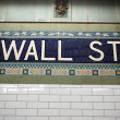 Wall street subway sign tile pattern in New York City Manhattan - Stock Photo