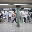 NEW YORK CITY - JULY 1: Commuters in subway station on July 1st, - Stock Photo