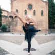 Young beautiful ballerina posing in front of St. Stephen church. — Stock Photo #19998671