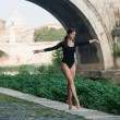 Young beautiful ballerina dancing under Castel Santangelo bridge — Stock Photo