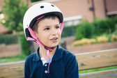 Six year old kid outdoor wearing helmet portrait. — Stock Photo