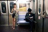 NEW YORK CITY - JUNE 28: Commuters in subway wagon on June 28, 2 — Stock Photo