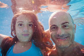 Father and daughter underwater close up portrait in swimming poo — Stock Photo
