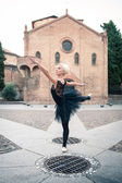 Young beautiful ballerina posing in front of St. Stephen church. — Stock Photo