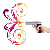Handgun with abstract flower drawings in the end of the barrel i — Stock Photo