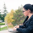 Young business woman using tablet computer outdoors. — Стоковое фото