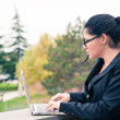 Young business woman using tablet computer outdoors. — Stok fotoğraf