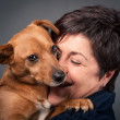 Stock Photo: Small dog and middle age woman.