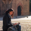 Woman using tablet in Saint Stephen square, Bologna, Italy. — Stock Photo #21629755