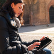 Woman using tablet in Saint Stephen square, Bologna, Italy. — Stock Photo