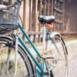 Detail of vintage bicycle leaning against a fence. — Stock Photo #21629777