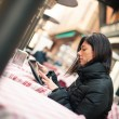 Woman using tablet outdoors sit in a bar. Shallow depth of field. — Stock Photo #21629869