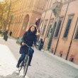 Stock Photo: Womriding bicycle in Bologna, Italy.