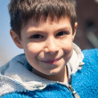 Close up portrait of smiling seven year old boy. - Stock Photo