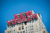 NEW YORK - JULY 2 : The New Yorker Hotel sign located on 8th. Avenue. — Stock Photo