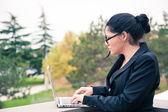 Young business woman using tablet computer outdoors. — Stock Photo