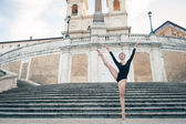 Young beautiful ballerina dancing on the Spanish Steps in Rome, Italy. Ballerina Project. — Stock Photo