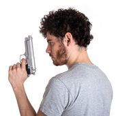 Young killer with gun portrait over white background. — Stock Photo