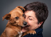 Small dog and middle age woman. — Stock Photo