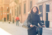 Woman riding bicycle in Bologna, Italy. — Stock Photo