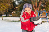 Young kid having fun in the snow with snowball. — Stock Photo