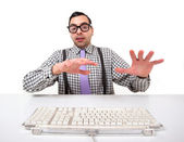 Computer geek portrait with keyboard and eyeglasses isolated on white background. — Stock Photo