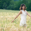 Young beautiful woman in a wheat field with white dress. — Stock Photo #23084238