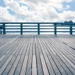 Empty pier at Coney Island beach, New York City. - Stock Photo