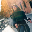 Woman riding bicycle in the city, Italy. — Stock Photo #23084442