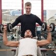 Man and his personal trainer exercising with dumbbells at the Gym. — Stock Photo #23084746