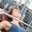 Young woman lifting the barbell in the gym.  — Stock Photo