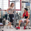 Royalty-Free Stock Photo: Young friends talking at the gym while training.
