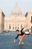 Young beautiful ballerina dancing in the street in front of St. Peter's Basilica, Rome, Italy. Ballerina Project. — Stock Photo