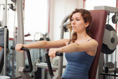 Young woman training in the gym. — Stock Photo