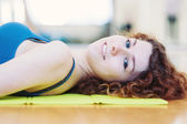 Close up portrait of young woman in the gym. — Stock Photo