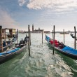 Gondolas in Canal Grande with San Giorgio maggiore island on bac — Stock Photo #42131113