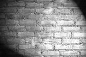 Spotlight on the brick wall — 图库照片