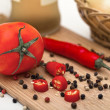 Stock Photo: Tomato and paprikon cutting board