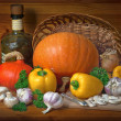 Still life of pumpkins, mushrooms, yellow pepper and parsley on a wooden table — Stock Photo