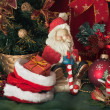 Santa Claus and Christmas candle — ストック写真
