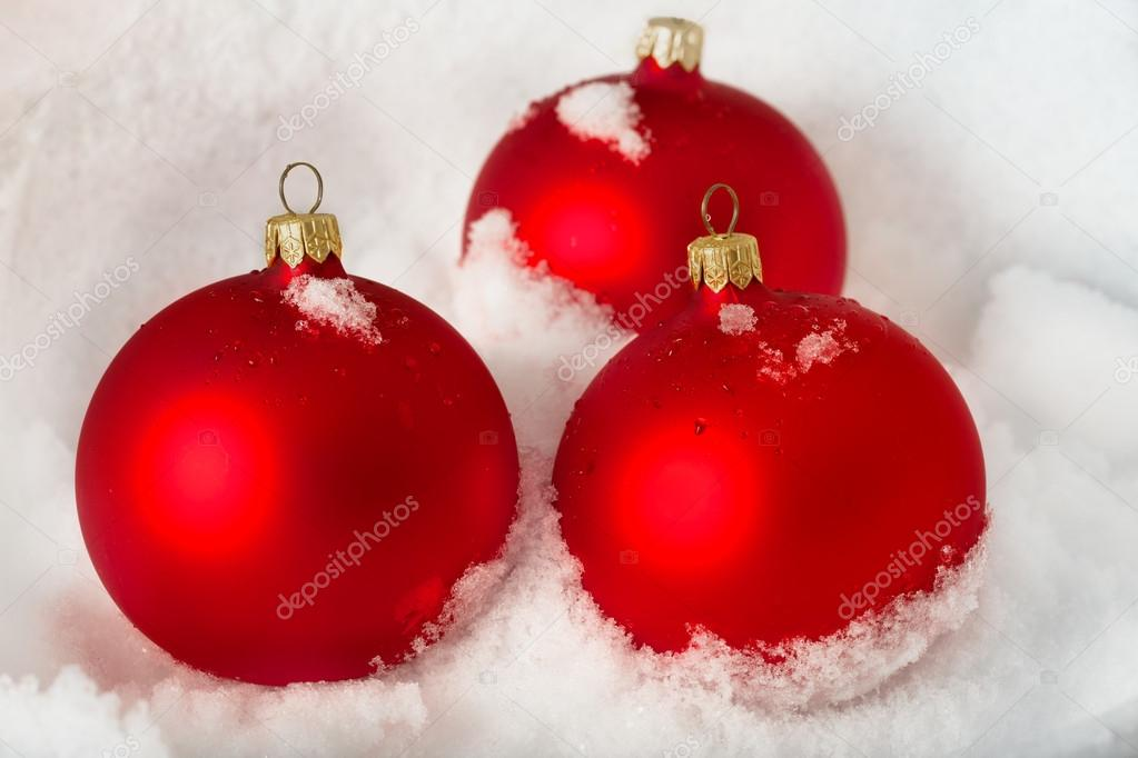 Three red Christmas balls on the white  snow  Stock Photo #17685237